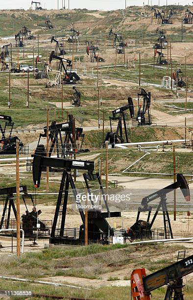 Oil pumps stand at the Chevron Corp Kern River oil field in Bakersfield California US on Tuesday March 29 2011 While most of the oil has been removed...