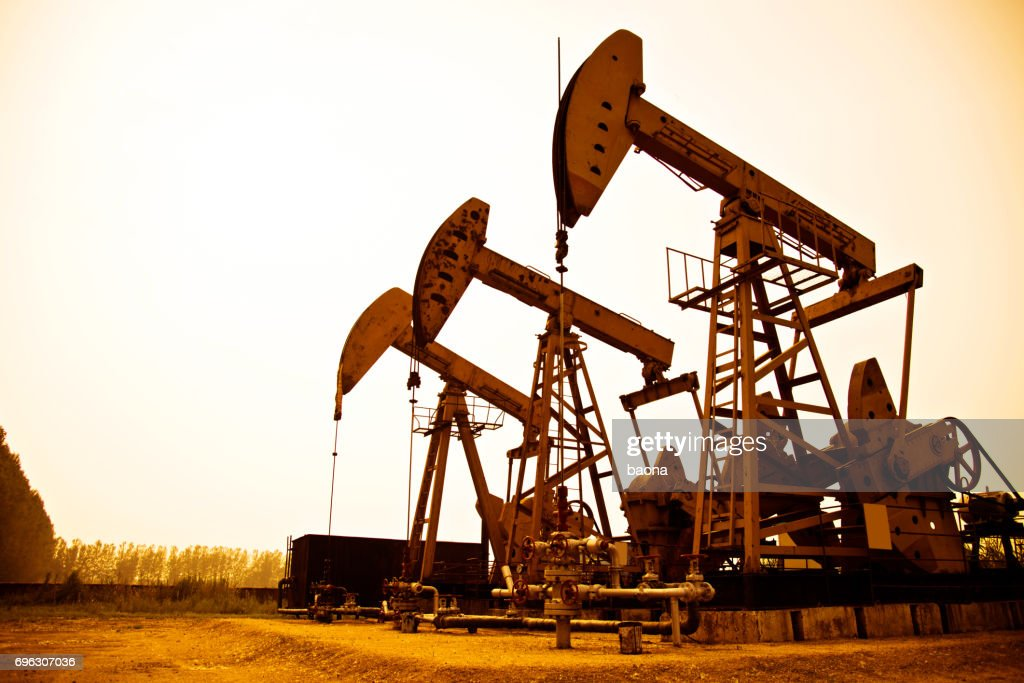 Oil pumps working at sunset : Stock Photo