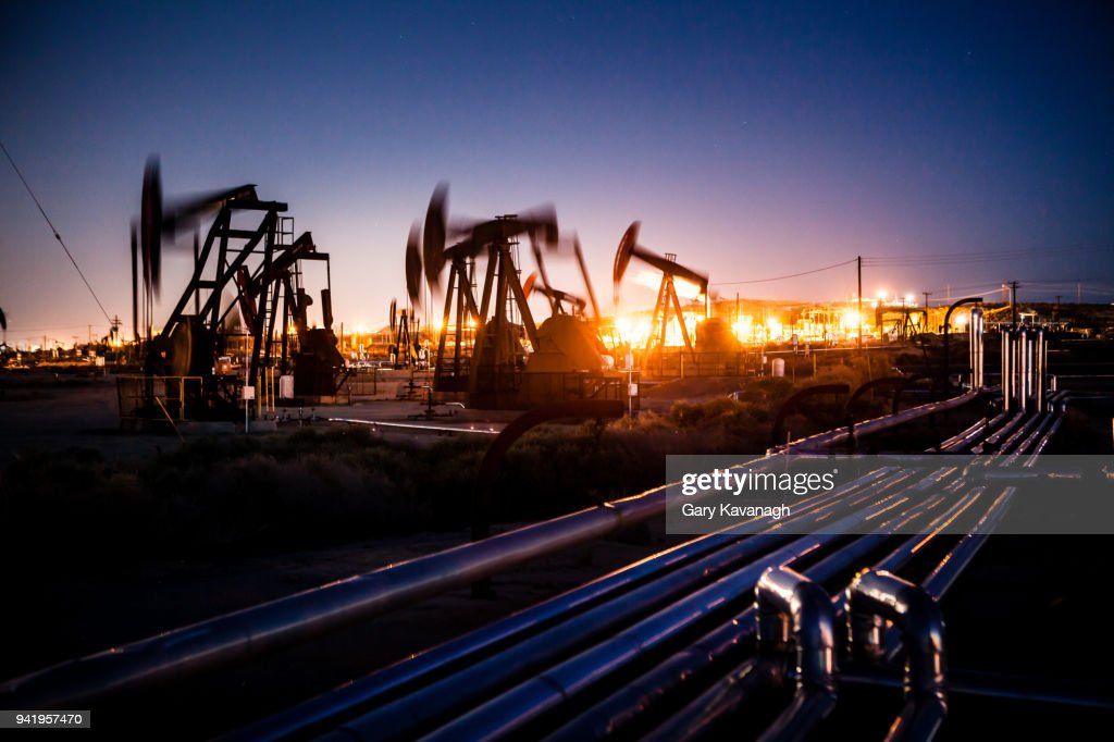 Oil pupjacks whiring at night : Stock Photo