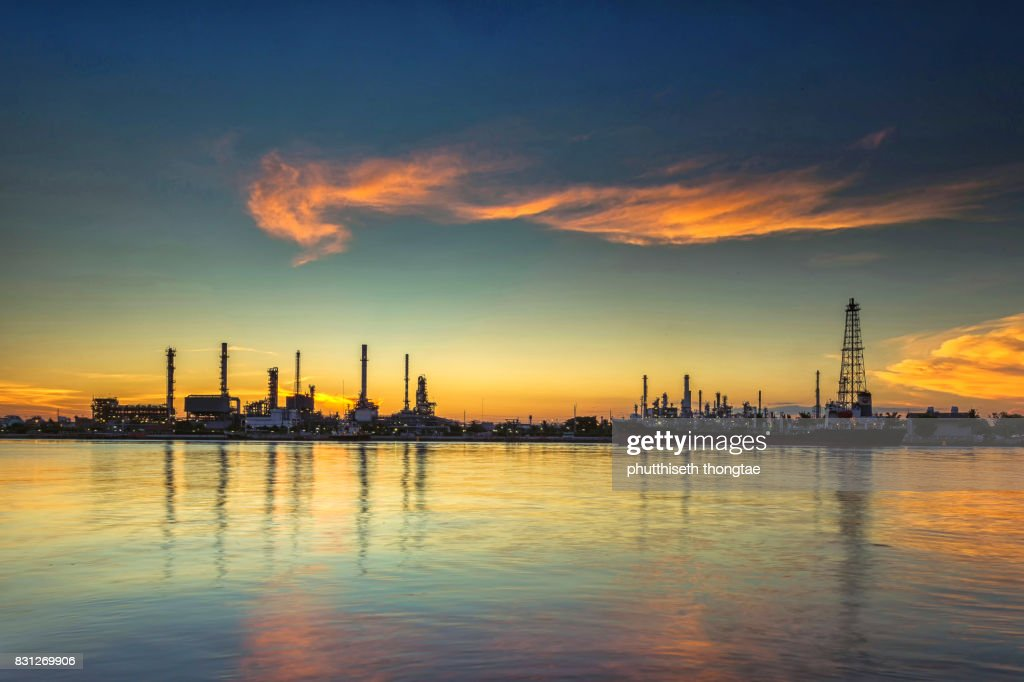 Oil refinery and petrochemical plant at sunrise.- Oil and gas industry : Stock Photo