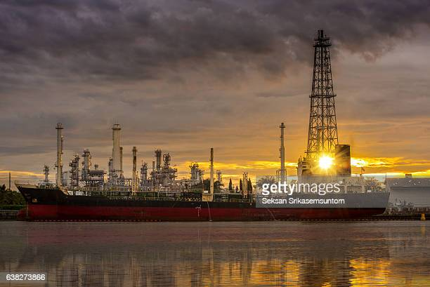 Oil refinery and Ship fuel delivery at sunrise
