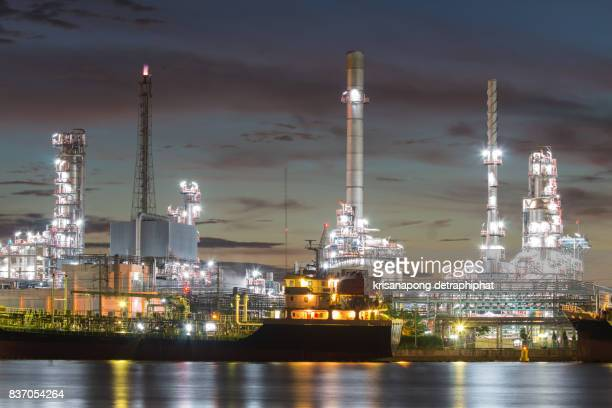 oil refinery and sun rise - power station stock pictures, royalty-free photos & images
