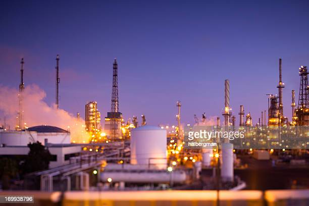 oil refinery at dusk (tilt-shift) - flare stack stock photos and pictures