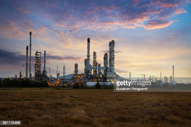 Oil refinery at sunrise background