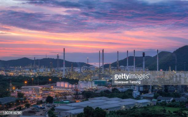 oil refinery at twilight - greenpeace stock pictures, royalty-free photos & images