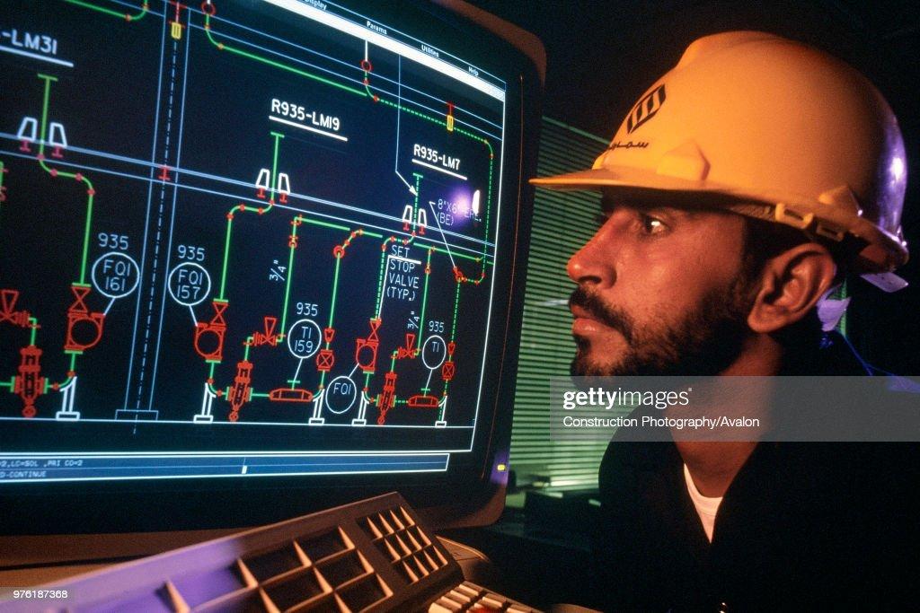 Oil refinery control room. Saudi Arabia. : News Photo