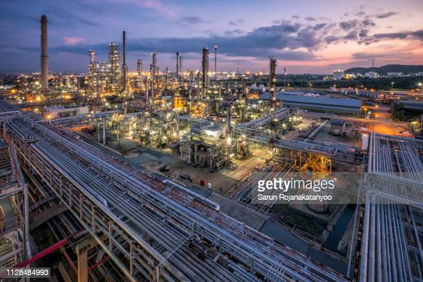 oil refinery during sunset - oil refinery stock pictures, royalty-free photos & images
