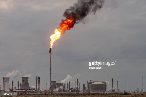 oil refinery flare stack - central scotland stock pictures, royalty-free photos & images