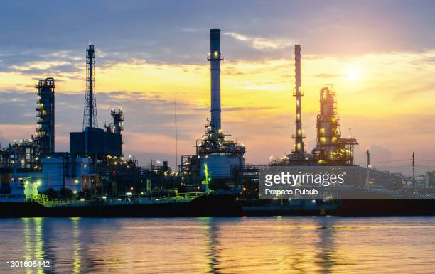 oil refinery or chemical plant at blue night sky - greenpeace stock pictures, royalty-free photos & images