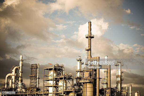 oil refinery - flare stack stock photos and pictures