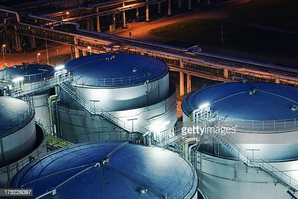 oil refinery - storage tank stock photos and pictures