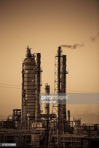 oil refinery (sepia) - carson california stock pictures, royalty-free photos & images