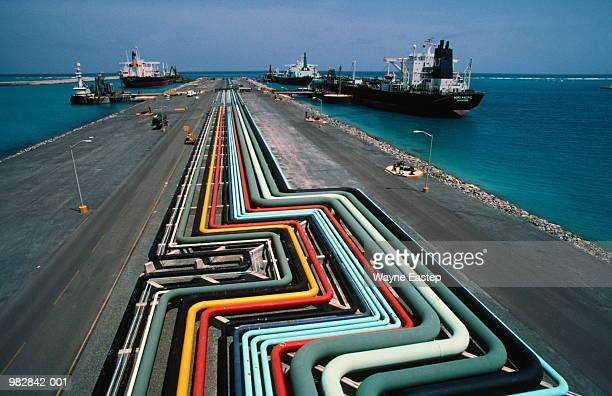 Oil refinery pipelines and docked oil tankers, elevated view