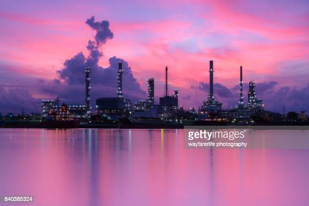 Oil Refinery Plant and its reflection over water surface at sunrise