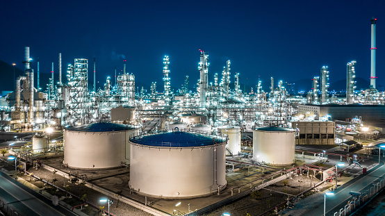 Oil refinery plant from industry zone, Aerial view oil and gas industrial, Refinery factory oil storage tank and pipeline steel at night. 1133785444