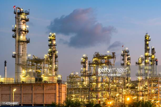 oil refinery power station at sunset - refinery stock pictures, royalty-free photos & images