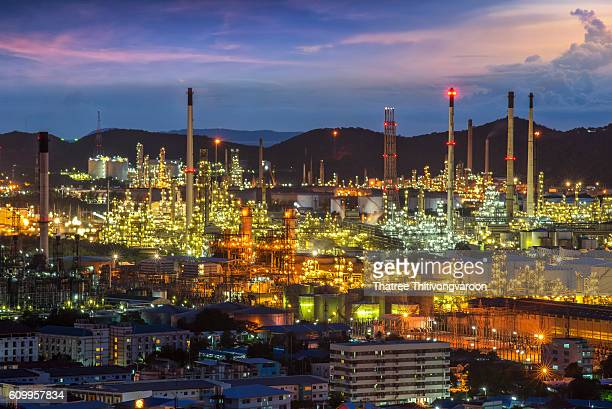 Oil refinery power station at twilight, Petrochemical industrial with city background at sunset , Si Racha District, Chon Buri , Thailand