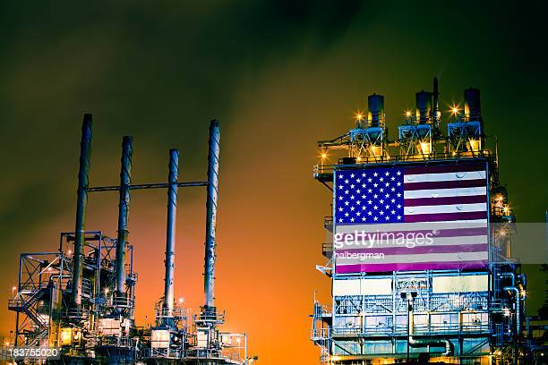 Oil Refinery with American Flag at Night