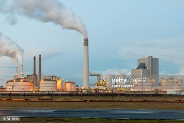Oil refinery with smoking at twilight