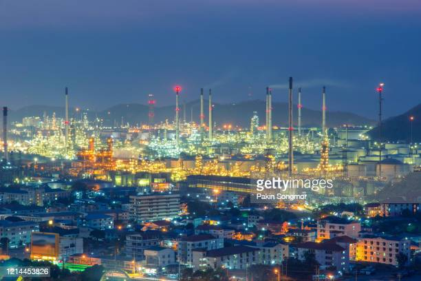 oil refinery with tube and oil tank along night sky at si racha district - greenpeace stock pictures, royalty-free photos & images