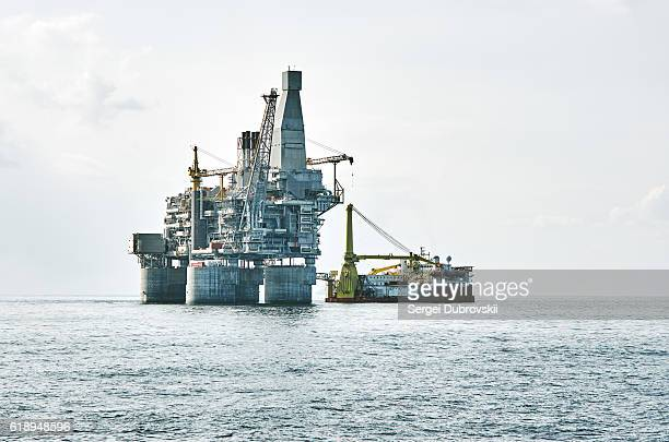 Oil rig and support vessel on offshore area