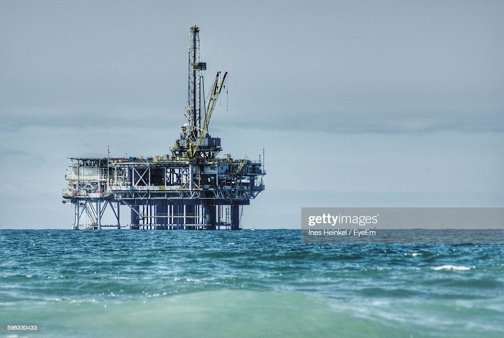 Oil Rig In Sea Against Sky : Stock Photo