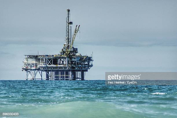 Oil Rig In Sea Against Sky