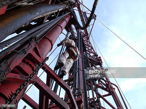 oil rig man working at height in the drilling derrick - oil worker stock pictures, royalty-free photos & images