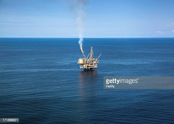 oil rig - flare stack stock photos and pictures