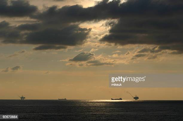 oil rig platform and tanker at sea - north sea stock photos and pictures