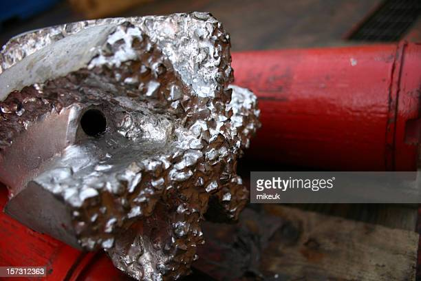 oil rig platform drill bit close up teeth detail - drill bit stock photos and pictures
