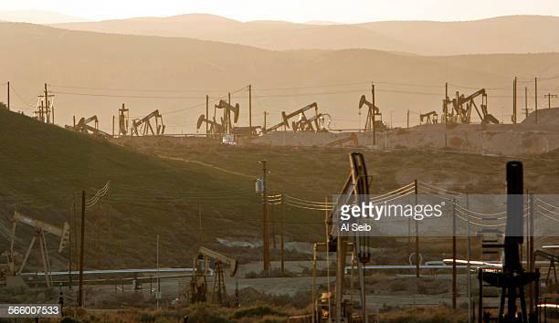 Oil rig pump jacks work the oil fields near the town of Maricopa located in the oil rich hills West of Bakersfield between Maricopa and Taft on March...