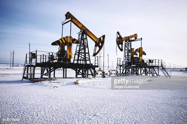 oil rig, snow winter, oil pump - russia stock pictures, royalty-free photos & images