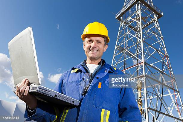 Oil Rig Worker and Laptop