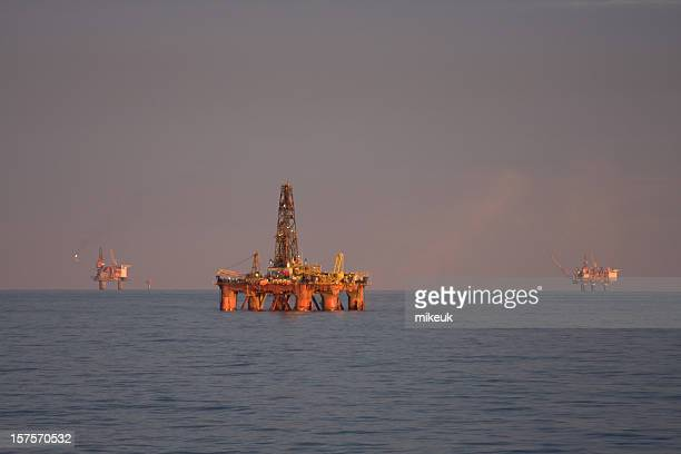 oil rigs at sea - north sea stock photos and pictures