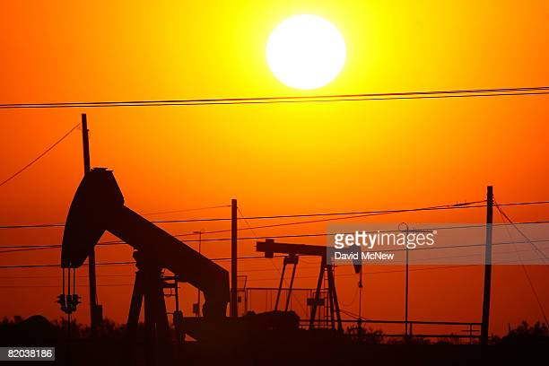 Oil rigs just south of town extract crude for Chevron at sunrise on July 22 2008 in Taft California Hemmed in by the richest oil fields in California...