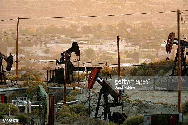 Oil rigs just south of town extract crude for Chevron on July 22 2008 in Taft California Hemmed in by the richest oil fields in California the oil...