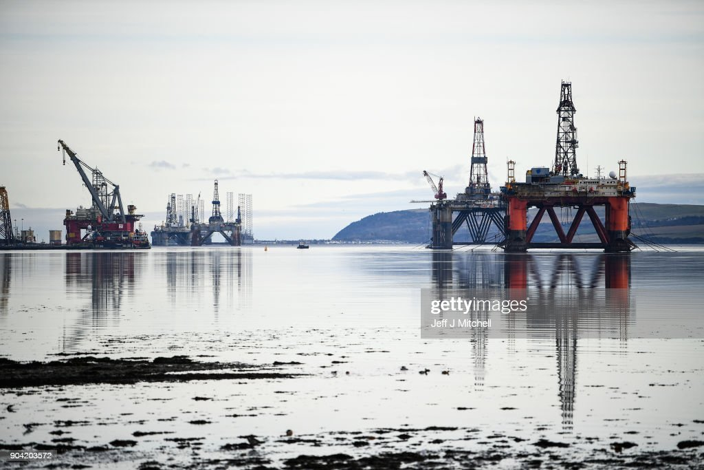 Oil rigs weighing thousands of tons are continuing to be stacked up in the Cromarty Firth on January 12, 2018 in Invergordon, Scotland. Rig platforms are being stacked up in the Cromarty Firth, awaiting orders to transport them to scrapyards, due to a lack of demand for their services following the North Sea oil downturn.