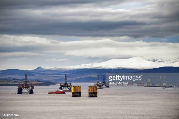 Oil rigs weighing thousands of tons are continuing to be stacked up in the Cromarty Firth on January 12 2018 in Invergordon Scotland Rig platforms...