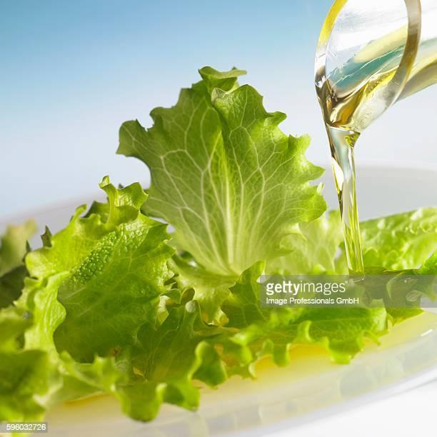 Oil running onto lettuce leaves