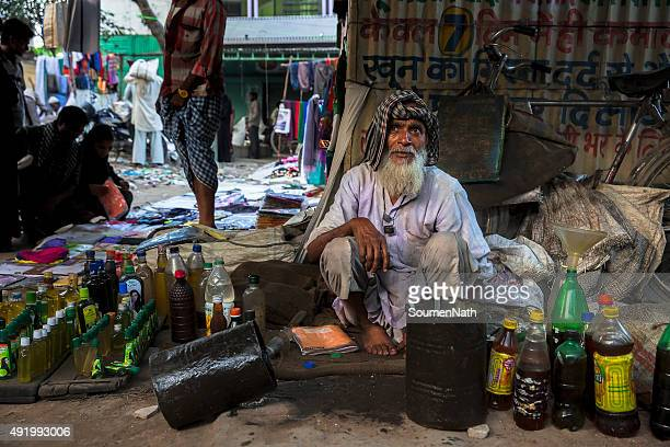 Oil seller waiting for customers