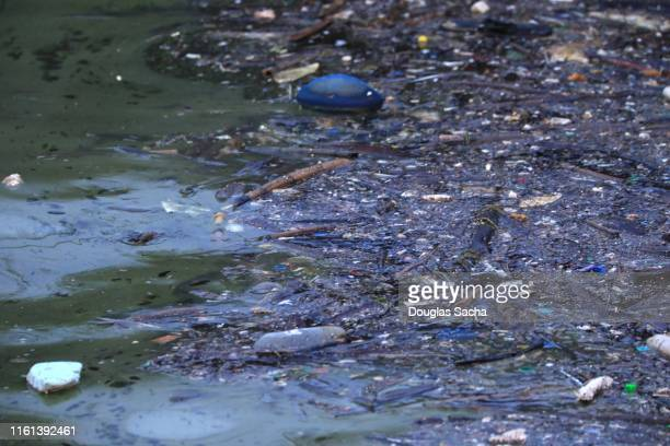 oil slick and debris in the ocean - environmental damage stock pictures, royalty-free photos & images