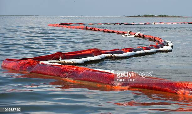 Oil soaked containment booms float near the Pelican Rookery off of Queen Bess Island near Grand Isle Louisiana June 10 in an area affected by the BP...