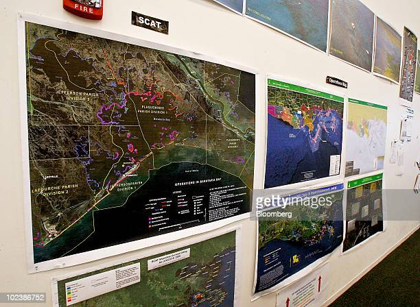 Oil spill maps and other satellite images sit on display in the Deepwater Horizon Incident Joint Information Center in Houma Louisiana US on Thursday...