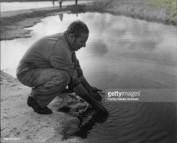 Oil spillage at the Ampol refinery in Yarra BayMr Merv Ryan supervisor washes his hands in the oil spill January 24 1981