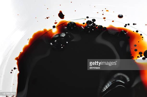 oil spilled into clear water in a white bowl - tar stock pictures, royalty-free photos & images
