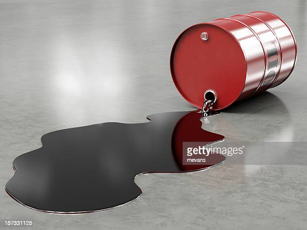 Oil spilling from red barrel onto floor