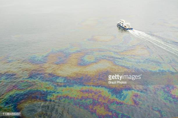 Oil spills below Rio-Niteroi bridge in Guanabara Bay - the bay has been heavily impacted by urbanization, deforestation, and pollution of its waters...