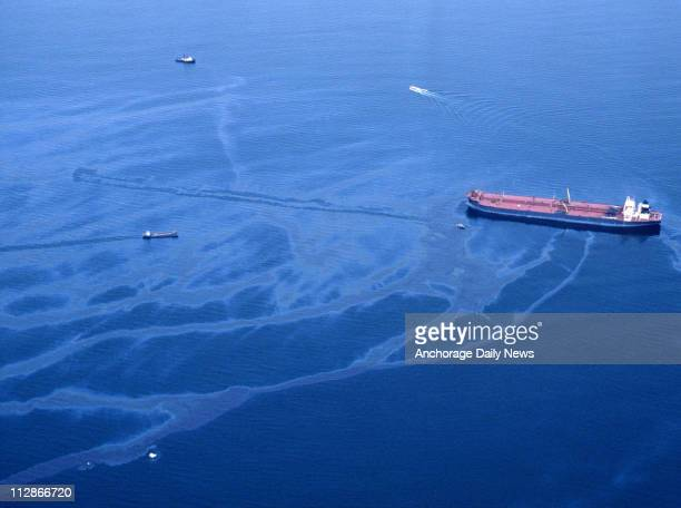 Oil spills from the crippled tanker Exxon Valdez the morning of March 24 after the vessel ran aground on Bligh Reef in Prince William Sound