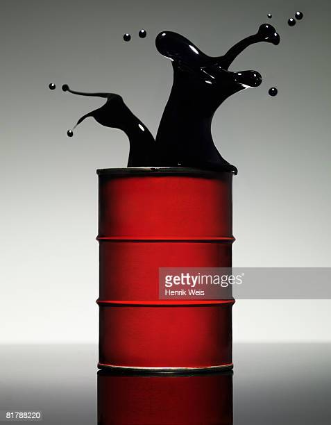 oil splash - drum container stock photos and pictures